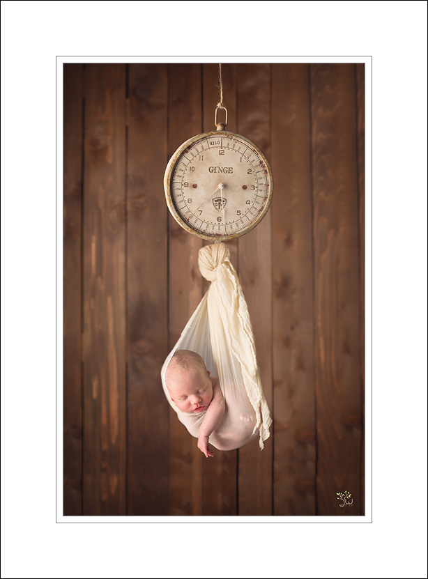 Seattle Newborn Photographer Jennifer Wilcox Photography Baby hanging from scale 1 Seattle Newborn Photographer ~ Sleep Pretty Darling